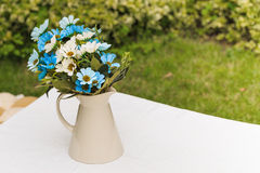 Decorated artificial flowers Stock Images