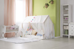 Decorated baby room. Cozy baby room decorated with toys and cotton balls royalty free stock image