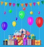 Decorated background with gift boxes. Decorated background with colorful balls, garland lights, balloons and pennant bunting. Lots of gift boxes. Greeting card Stock Photography