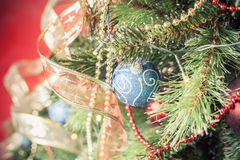 Decorated ball on Christmas tree Royalty Free Stock Image