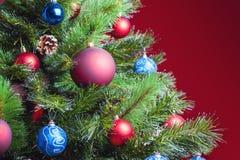 Decorated ball on Christmas tree Stock Image