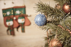 Decorated ball on Christmas tree with wooden background Royalty Free Stock Photo