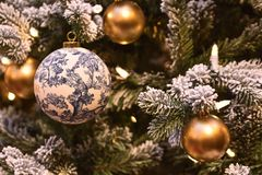 Decorated ball on a New Year tree stock images
