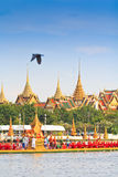 Decorated barge parades past the Grand Palace at the Chao Phraya River Royalty Free Stock Photos
