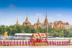 Decorated barge parades past the Grand Palace at the Chao Phraya River Stock Image