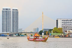 Decorated barge parades past the Grand Palace at the Chao Phraya River Royalty Free Stock Photography