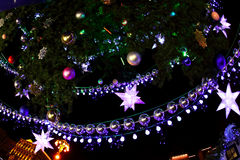 Decorated with baubles and garlands Christmas tree and city ligh Royalty Free Stock Photos