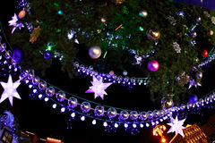 Decorated with baubles and garlands Christmas tree and city ligh Stock Photo