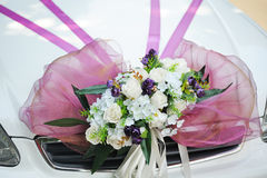 Decorated with a beautiful bouquet on wedding car Stock Image