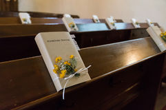 Decorated bible on a pew for a church wedding in Germany Stock Images