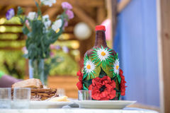 Decorated big bottle of alcohool Royalty Free Stock Photos