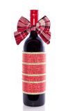 A decorated bottle of red wine Royalty Free Stock Images