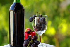 Decorated bottle of red wine stock photos
