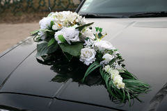 Decorated with a bouquet of flowers on wedding cars Stock Photos