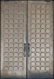 Decorated Brass Doors. A set of double brass doors with a square and circular pattern. Large handles provide a sense of scale Royalty Free Stock Photos