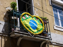 Decorated brazilian flag on a balcony in Lisbon Royalty Free Stock Photo