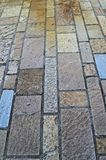 Decorated bricks tiles sidewalk, close up Royalty Free Stock Photo
