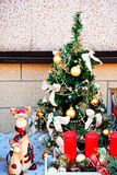 Decorated with bright and colorful toys small Christmas tree. Royalty Free Stock Photography