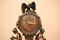 Decorated bronze clock. It's 3 O'Clock. Stock Photography