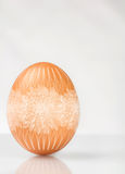 Decorated brown Easter egg. Stock Photos
