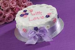 Decorated Cake. With pink roses on a purple background Royalty Free Stock Photo