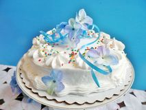 Decorated cake with blue background Royalty Free Stock Images