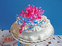 Decorated cake with blue background Stock Photo