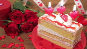 Decorated cake with candles and roses on wood stock video