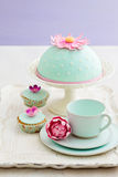 Decorated cake and cupcakes Stock Photos