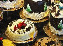 Decorated cakes. Colorful fancy gourmet cakes with cream, chocolate, fruit Stock Images