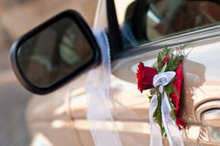 Decorated cars door. Cars side door and mirror decorated with bouqet and band Royalty Free Stock Photos