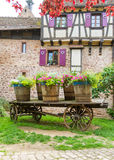 Decorated cart in the historic village of Riquewihr,Alsace. Stock Photos