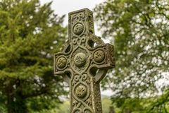 A decorated Celtic cross monument in nature. royalty free stock photos
