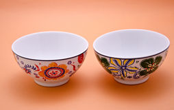 Decorated ceramic pots. Close-up on a background color Royalty Free Stock Photo