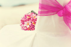 Decorated chair wedding arrangement on the beach Stock Photography
