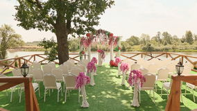 Decorated with chairs and arch prepared for the wedding ceremony stock video footage