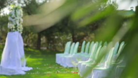 Decorated Chairs And Arch    At Wedding Ceremony stock video footage