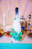 The decorated champagne bottle Stock Images