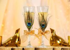 Decorated champagne glasses for wedding stock photography