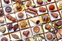 Decorated chocolate. A collage of decorated fancy chocolates on a grid pattern Stock Photo