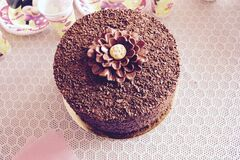 Decorated chocolate cake on table Stock Image