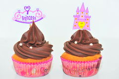 Decorated chocolate cupcakes. Chocolate cupcake for little pricesses Royalty Free Stock Photography