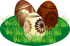 Decorated chocolate eggs in a stylized lawn Royalty Free Stock Photography