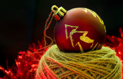 Decorated Christmas ball on black background Stock Image