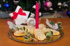 Decorated christmas braided bread near christmas tree. Stock Photos