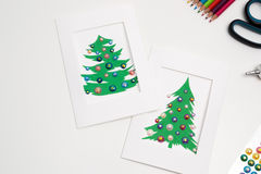 Decorated Christmas cards. Handmade New Year decorations Stock Image