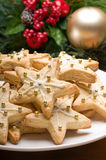 Decorated christmas cookies in festive setting Stock Photo