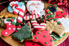 Decorated Christmas cookies on golden plate Stock Photo