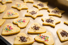 Decorated Christmas cookies ready for baking Royalty Free Stock Photo