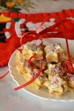 Decorated Christmas cookies on the white plate on the table Stock Image